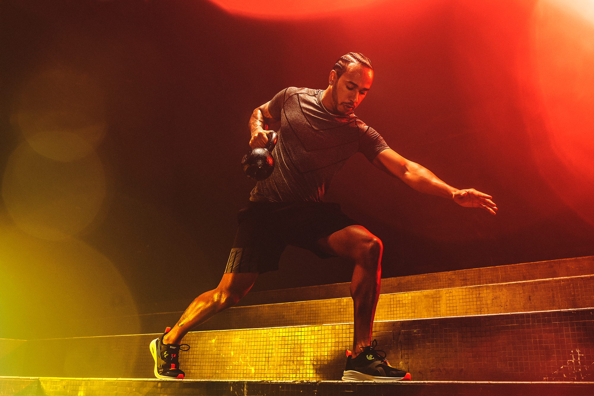 Lewis Hamilton, Formula 1 Champion. Working out with Kettle Bells. Puma Running and Training Hybrid.