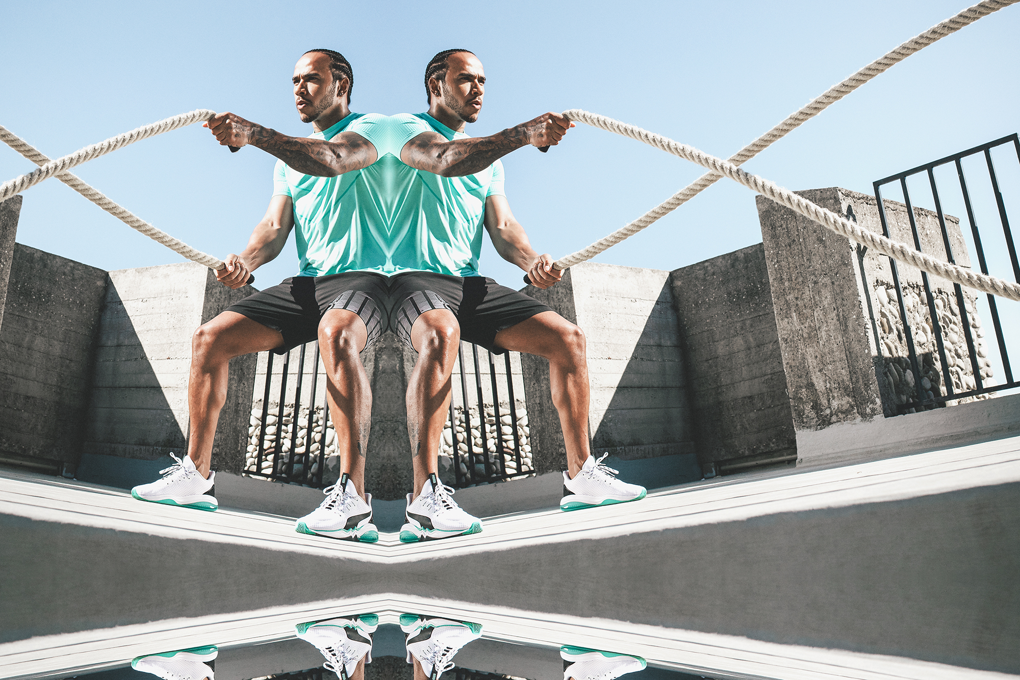 Lewis Hamilton Formula 1 champion in PUMA LQD Cell battle rope