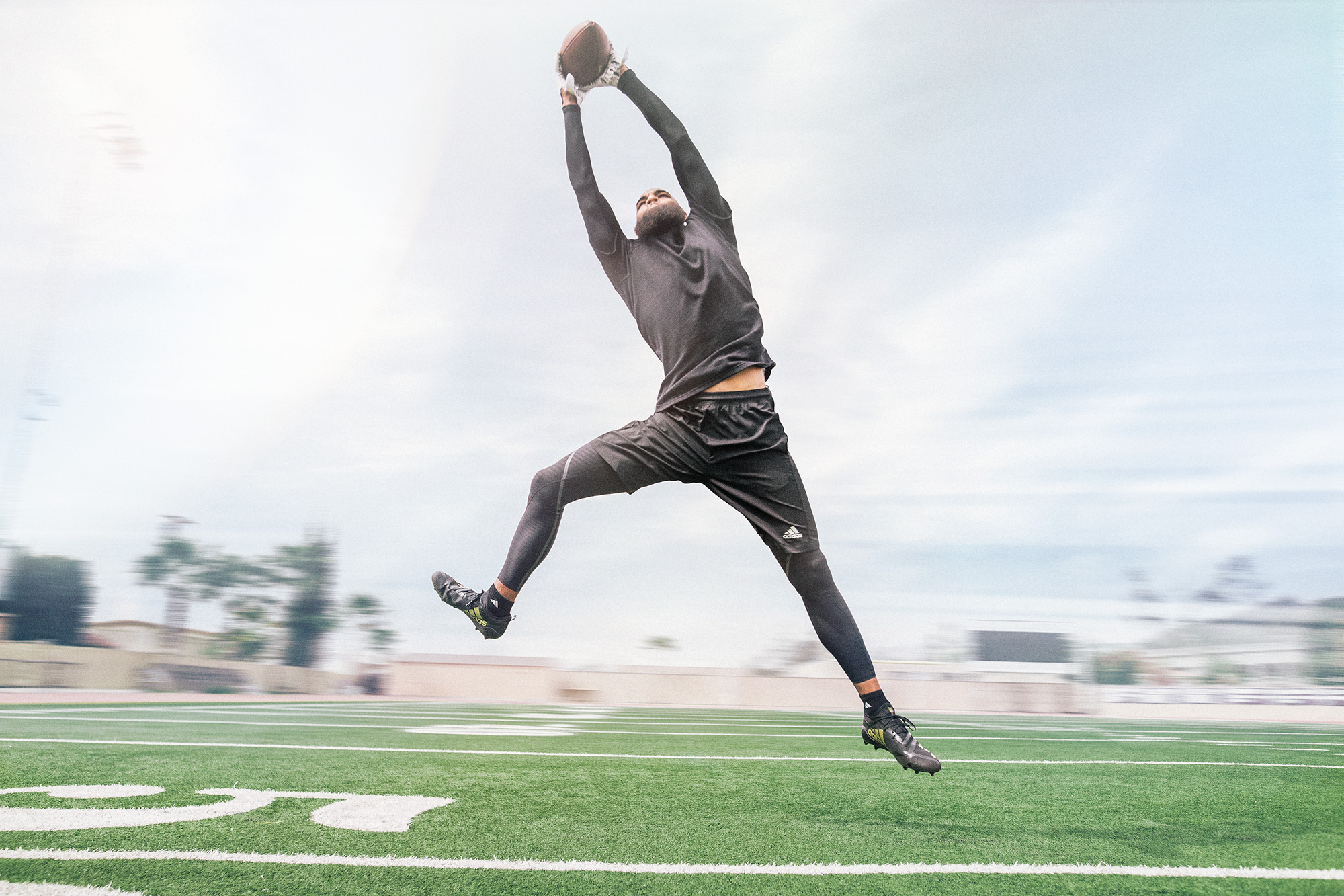 keenan allen, Wide Receiver, catching a pass. Photographed for Adidas Football on Location in LA.